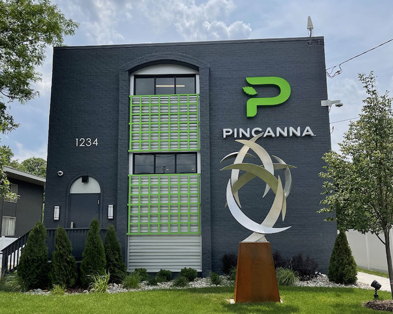 the front facade of a new Pincanna retail location in east lansing