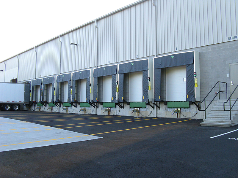 A shipping bay with Baron Industries hanging doors