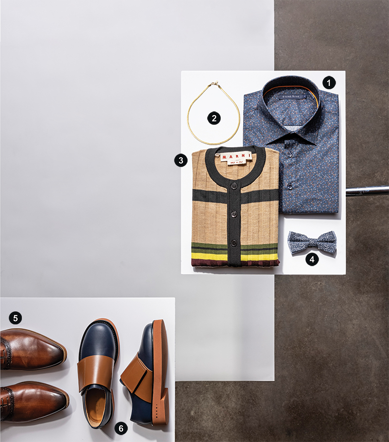 a stylized arrangement of clothes: a necklace splayed circularly to the left of a navy floral button-down shirt, which has its bottom left corner overlapped by a Marni striped Sweater. In the bottom left, the toes of a pair of brown shoes emerge from the left of the frame, and a pair a navy and brown flats sit to the right.