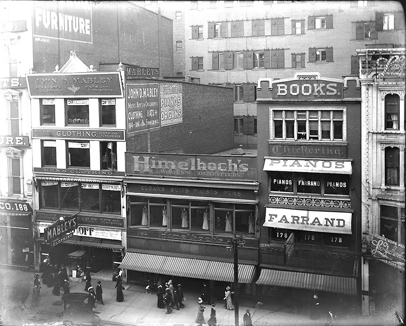 A Stitch in Time - The Himelhoch family opened their first store in 1876 before establishing a presence on Woodward Avenue in downtown Detroit in 1907 (shown). Growing to multiple locations, the business eventually closed in 1979, but today lives on as an online fashion house featuring multiple designers. Carol Himelhoch, opposite page, stands in front of the company's former bricks-and-mortar location just south of the David Whitney Building, which has since been converted into a residential and commercial development. // Courtesy of Carol Himelhoch