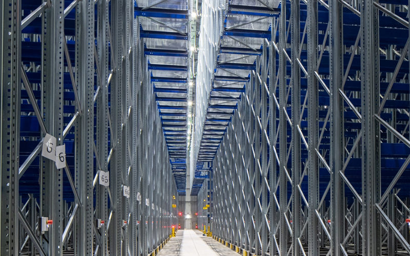 looking down the aisle of a massive cold storage warehouse
