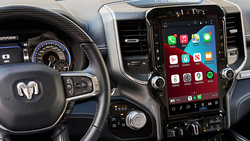 Interior of a Ram truck with uconnect 5 on the telematics screen