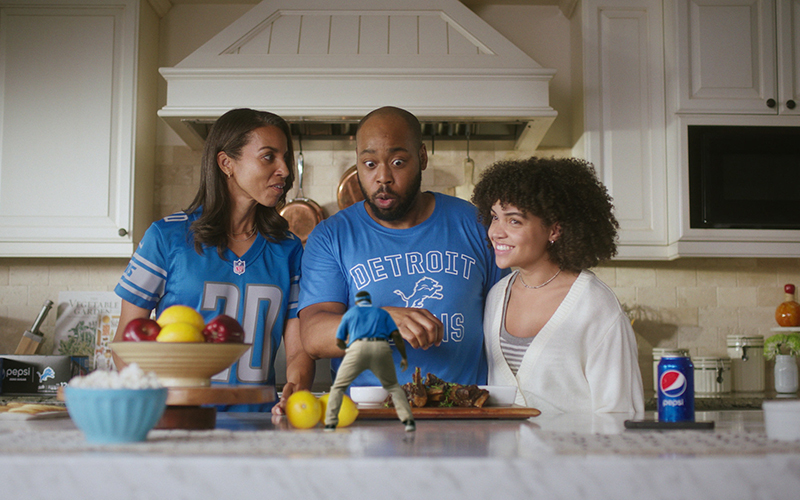 a family making gameday snacks at a kitchen island