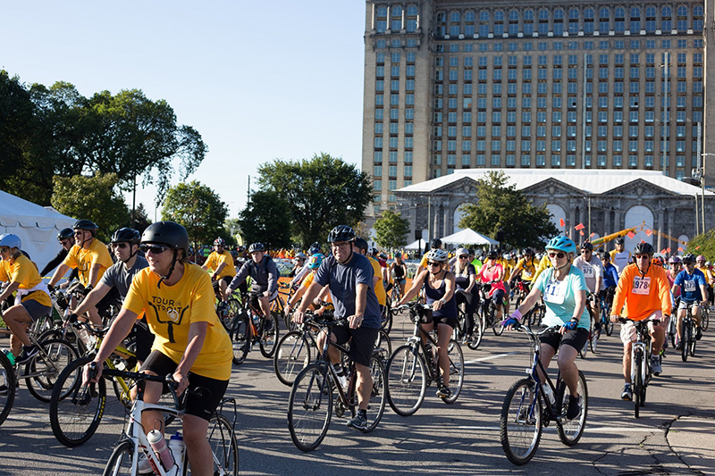 Rider begin peddling at the 2019 Tour de Troit outside Michigan Central Station