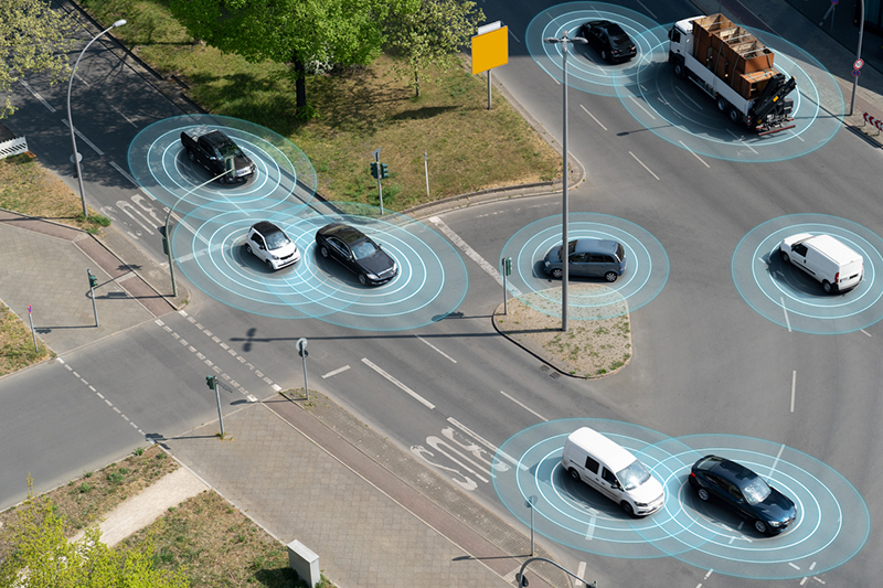 Self driving autonomous cars on multi lane city street. The cars are using radar sensors, wireless communication, GPS and artificial intelligence to navigate and communicate with each other.