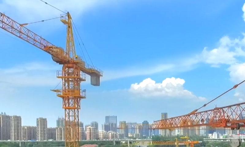 construction cranes over a city skyline