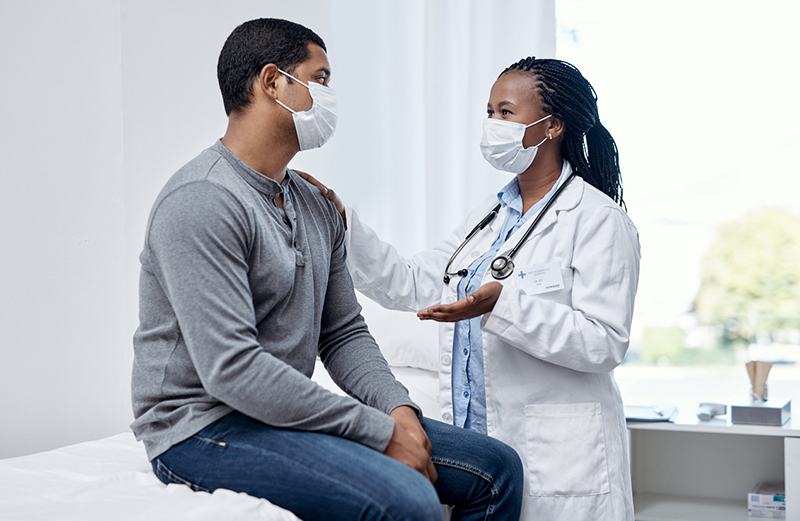 a doctor talks to a patient in an office